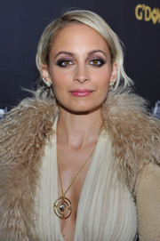 Nicole Richie went for a bold makeup look with purple eyeshadow and smoky corners.