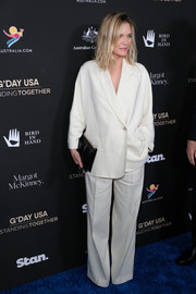 Michelle Pfeiffer opted for a slouchy white pantsuit when she attended the 2020 G'Day USA Gala.