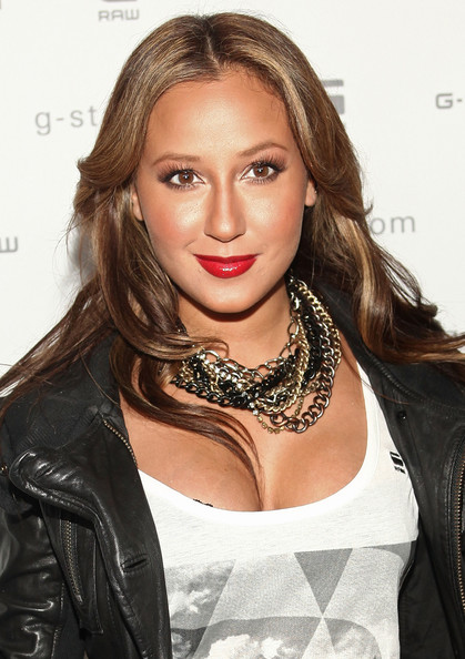 Adrienne Bailon spiced up her glamorous look with ravishing red lipstick.