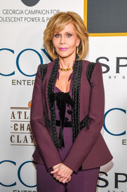 Jane Fonda looked refined in a purple Elie Saab blazer with black velvet trim during her 80th birthday celebration.