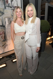 January Jones was casual and cool in a white crop-top at the General Public x RH celebration.