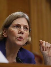 Elizabeth Warren accessorized with a simple pair of gold studs.
