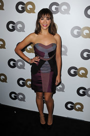 Rashida Jones paired a muli-colored strapless dress with versatile black pumps. Red lipstick completed her party look.