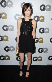 Jena Malone paired her chiffon sequin Paule Ka dress with strappy black suede heels with Swarovski crystal detail.