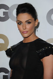 Taylor Cole added some flair to her look with fluttering lashes and soft pink lips.