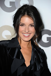 Shenae Grimes opted for elegance at the Men of the Year party. She donned a loose updo with face framing bangs.