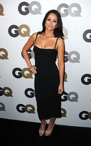Nicole is super sultry in this chic black dress.