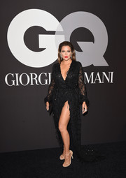 Khloe Kardashian flashed her black undies in a high-slit, embellished wrap gown by Constantina and Louise during the GQ and Giorgio Armani Grammy after-party.