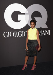 Estelle paired her trendy top with a black mesh pencil skirt.