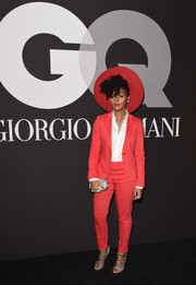Janelle Monae cut a striking figure in a crimson pantsuit and a matching wide-brimmed hat during the GQ and Giorgio Armani Grammy after-party.