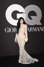 Kylie Jenner totally smoldered in a sheer, embellished cutout gown by Steven Khalil during the GQ and Giorgio Armani Grammy after-party.