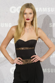 Toni Garrn looked alluring in a strapless, lace-panel corset top at the GQ Men of the Year Awards photocall.