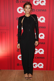 Cheyenne Tozzi chose a dramatic black cutout dress with glittery sleeves for the GQ Men of the Year Awards.