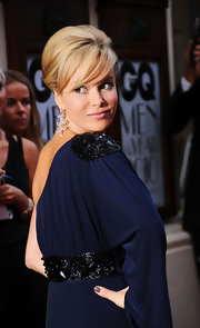 Amanda Holden looked stunning with a retro-style updo and thick bangs at the GQ Men of the Year Awards.