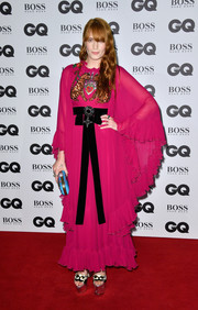 Florence Welch was a hippie babe in a ruffled fuchsia maxi dress by Gucci at the GQ Men of the Year Awards.