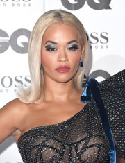 Rita Ora went bold with a heavy application of metallic eyeshadow.