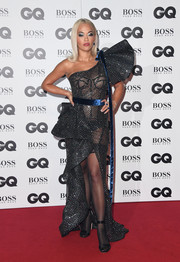 Black satin sandals finished off Rita Ora's look.