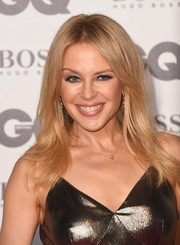 Kylie Minogue framed her face with a feathery 'do for the 2018 GQ Men of the Year Awards.