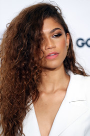 Zendaya Coleman contrasted her edgy eye makeup with a sweet pink lip.
