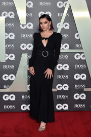 Strappy silver heels polished off Charli XCX's look.