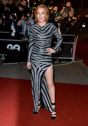 Lindsay Lohan made a fierce appearance at the GQ Men of the Year Awards in a Balmain zebra-beaded gown featuring a hip-grazing slit.