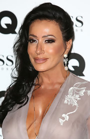 Nancy Dell'Olio glammed it up with a pair of dangling pearl and diamond earrings at the GQ Men of the Year Awards.