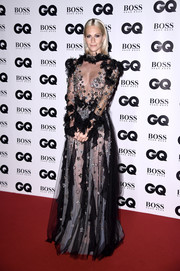 Poppy Delevingne got majorly flirty in a sheer star-and-ruffle-embellished gown by Reem Acra at the GQ Men of the Year Awards.