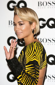 Rita Ora went for an offbeat beauty look with exotic cat-eye makeup during the GQ Men of the Year Awards.