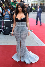 Kim Kardashian styled her racy bodysuit with a crystal-studded, floor-sweeping silver skirt by Ralph & Russo Couture.