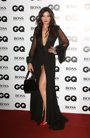 Daisy Lowe complemented her sultry dress with a classic black velvet purse when she attended the GQ Men of the Year Awards.