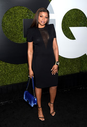 Taraji P. Henson looked seductive at the GQ Men of the Year party in a little black dress with a cleavage-baring sheer panel.