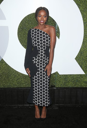 Aja Naomi King went for a modern vibe in a black-and-white honeycomb-patterned one-shoulder dress by Roland Mouret at the GQ Men of the Year party.