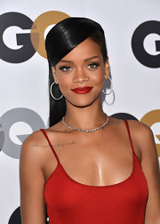 Rihanna matched her lips to her sexy slip dress at the GQ Men of the Year Party.