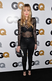 Dakota showed off her fit figure with a pair of slinky black pants and a lace blouse.