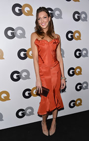 Katie looked artsy in this rustic orange satin dress at the GQ Men of the Year Party.