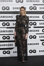 Adriana Abenia made a sultry statement at the GQ Men of the Year Awards in a sheer black gown with swirly embroidery.