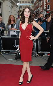 Alison Brie looked foxy at the 2012 GQ Men of the Year Awards in a red cocktail dress with a plunging neckline.