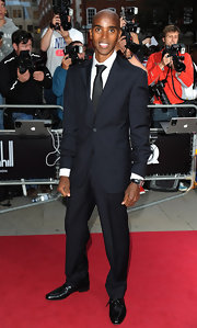 Mo Farah added some contrast to his dapper look with a classic solid black tie.