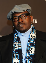 Randy Jackson wore a patterned scarf to the GQ XLV Super Bowl Party.