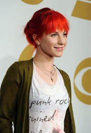 Hayley Williams added vibrant color to the red carpet with her fiery updo. Blunt cut bangs and a loose bun completed her look.