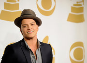 Bruno Mars added a little flair to his relaxed suit with a taupe fedora hat.