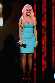 Nicki Minaj spoke on stage at the Grammy Nominations Concert in an aqua corset dress and pink hair.