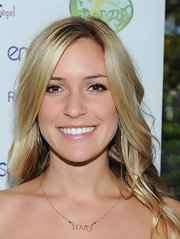Kristin Cavallari wore a Love pendent necklace to the Annual Family Earth Day celebration.