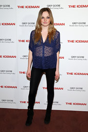 Emily Meade showed just a touch of skin with this sheer button down in a deep royal blue.