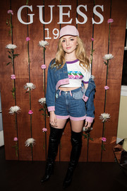 Peyton List layered a blue and pink denim jacket over a crop-top, both by Guess, for the brand's fragrance launch.
