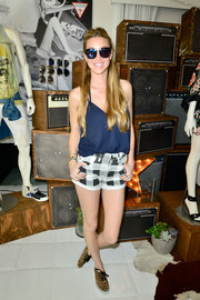 Whitney Port teamed her cami with a fun pair of black-and-white checkered shorts.