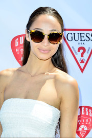 Cara Santana accessorized with a stylish pair of tortoiseshell cateye sunglasses when she attended the Guess Hotel party.