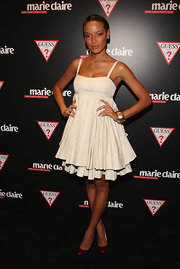 Selita looked sweet in a tiered white dress with shimmery red Bianca pumps.