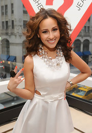 Adrienne Bailon wore a clearly amazing statement necklace while attending the grand opening of Guess on 5th Avenue in New York.