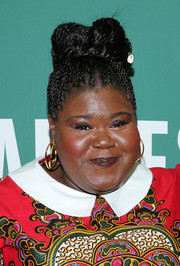 Gabourey Sidibe styled her hair into a cornrow updo for her book signing.